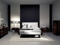 Symmetry is beautifully achieved in this stunning Martin Daniel Interiors' bedroom collection. Handcrafted furniture and astute design creates a sleek and upscale environment.