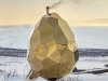 A'Design Award — The Solar Egg: Winner of an A'Design Award, the Solar Egg is a public sauna in Kiruna, Sweden, that is constructed with stainless golden mirror sheeting. The egg's interior is made of wood, with the wall panels and floor decking made out of pine. The bench is made of aspen. In the centre of the egg stands the wood-heated, heart-shaped sauna stove made of iron and stone | Photo courtesy of A'Design Award