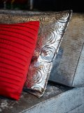 A Dior pleated cushion in a shade of red the designer created himself in 1947