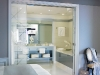 One of the three spacious bathrooms in the suite containing frosted glass doors