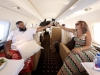 First Class: Khaled celebrates life as he toasts with Mama Asahd, his wife Nicole Tuck, on a private jet