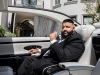 """With the top down, DJ Khaled sits in the car that was featured in his single """"Top Off"""" 