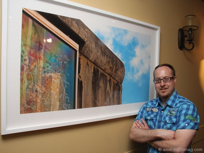 Artist Frank Michael poses next to his powerful work.