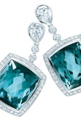 The diamond drop earring steps outside the box with dazzling blue tourmaline and a platinum backdrop.