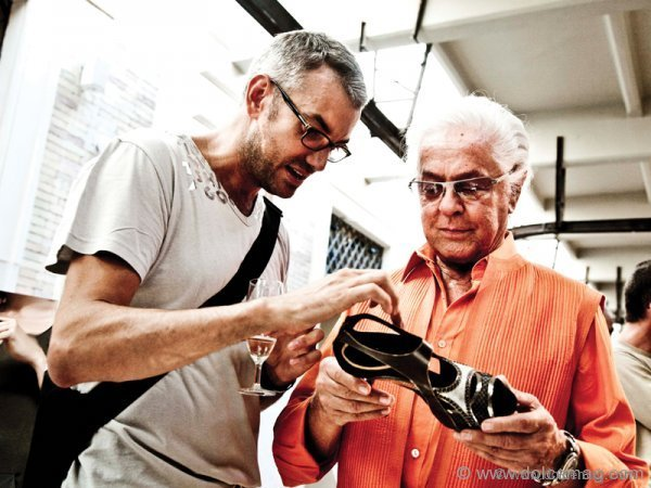 "Conquering the feat of footwear, shoe designer Diego Dolcini explains his latest masterpiece to ""the Givenchy of Rome,"" Italian fashion designer Roberto Capucci."