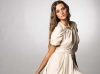 Slip into crisp, clean elegance with this cream-coloured dress cinched at the waist.