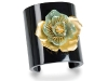 Wrap your wrist in Bochic's black Bakelite cuff with jade and gold flower detailing to enrapture.