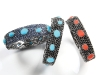 The Cuff Bangle, offered in pavé London blue topaz with turquoise cabochons or black onyx and coral cabochons, adds casual elegance for a signature look.