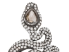 Slender and sexy, this serpent ring from Sutra holds a marvelous jewel surrounded by sparkling diamonds.