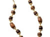 Kenneth Jay Lane elegantly entwines African elements with this earthy gold Wood Bead Necklace.