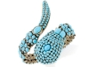 Available from Iris Apfel's Home Shopping Network line, this turquoise snake charmer multi-stone cuff bracelet gives a ssslender, sssensational look. Photo By Vanessa Lenz Photography