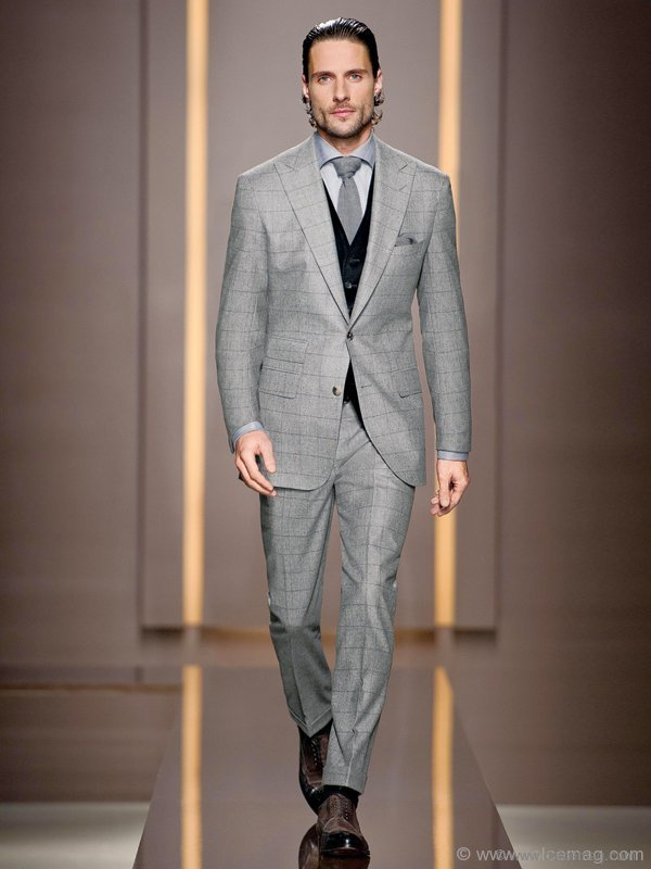 Every businessman looks great in a grey suit. I like showing grey these days with purple or black. The other thing I love to do with a grey suit is show it with a brown or tan shoe. It looks so great off-setting the grey or brown with a matching belt. 'Lenard/Gardens' suit by BOSS Selection 'Cremm' shoes by BOSS Selection