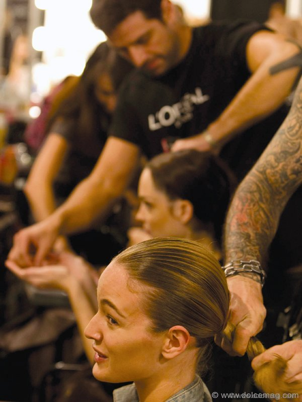 Stylists prep models behind the scenes during Madrid's Spring/Summer 2011 Fashion Week.