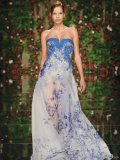 Semi-transparent Gown: Embroidered with royal blue floral arrangements, this flowing, semi-transparent gown is a graceful display of divine beauty that is sure to floor potential suitors.