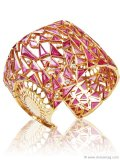 Amrapali Cuff: Sharp pink tourmaline triangles blend beautifully with the gold frame of this marvellous Amrapali cuff. This golden band will make you the centre of attention at any black-tie affair.
