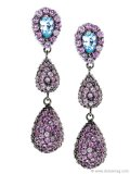 Matthew Campbell Laurenza Earrings: With three tiers of dangling pink sapphires, these lovely pavé drop earrings from M.C.L. by Matthew Campbell Laurenza will have you sparkling under the soft lights of those sultry summer events.