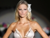 Madrid Fashion Week proved that a flower hair accessory, when done right, can add extra femininity to any bikini ensemble.
