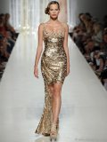 Dripping with glitz and glam, this couture cocktail dress by Tony Ward catches the eye with gold sequin embellishments and a train that will leave admirers starry eyed.