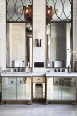 Country chic takes on new meaning in this glam master ensuite bathroom. Designed and built by the FR firm, it features floor-to-ceiling marble walls with mirrors, bronze frames and transoms, and an oversized spa shower with three sets of shower heads and controls