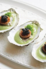 Huîtres & Caviar: The poached oysters are placed on a bed of leek velouté, then topped with toasted brioche and caviar.