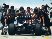 Photo opportunity for the World Press as the Red Bull car comes into the pits after hot laps. (Photo by Lat Photographic)