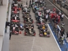 The F1 cars park for final inspection by officials after the race.