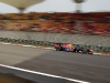 Red Bull Racing's Sebastian Vettel zips through the track at full speed.