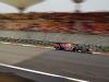 Red Bull Racing's Sebastian Vettel zips through the track at full speed.