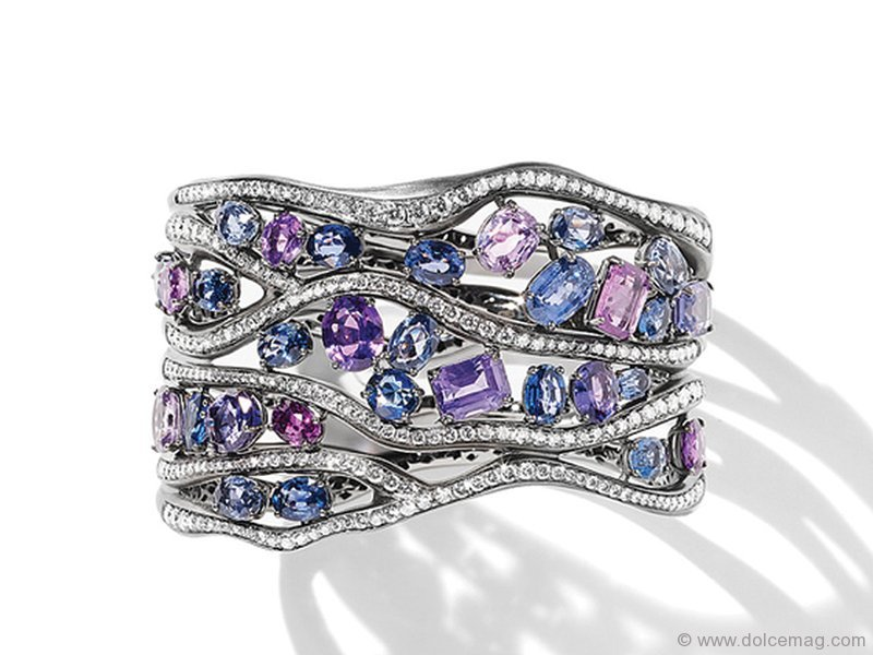 Unexpected lines and spring-hued jewels synchronize stunningly with diamonds in this unique bangle www.antonini.it Retailer - Holt Renfrew