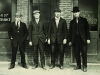 The four founders stand in front of the original Harley-Davidson workshop.