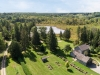 Along with the seven-acre kettle lake, this 101-acre property includes a four bedroom country home, a two- bedroom bunkie, a tennis court, a stone fire pit and a restored century barn with a workshop and winery room | Photos courtesy of Moffat Dunlap