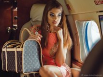 Wherever your destination, channel sizzling temperatures by slipping into hot hues and lush details / Dress, Holt; earrings, Nordstrom; ring, Henri Bendel; bag, Louis Vuitton