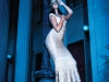 Outshine the moon in a curve-hugging bandage gown that blurs the line between sultry and sexy / Gown, Hervé Léger; Necklace, L George Designs