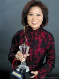 Helen Ching-Kircher proudly displays her 2009 Entrepreneur of the Year Award.