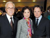 Dr. Peter Kircher and Helen Ching-Kircher with actor Michael J. Fox.