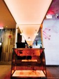A sushi restaurant looks chic with a salmon-coloured backlight.