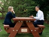 President Barack Obama and Secretary of State Hillary Rodham Clinton speak together sitting at a picnic table