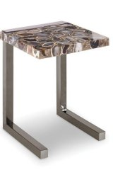 """When """"natural"""" and """"mod"""" come together, beautiful things happen — as seen in this Agate Composite Task Table by Kravet, which features a glossy mesh of stones on its surface 