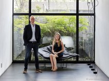 Principal architect Enrico Daffonchio and project architect Frances Joynt enjoy the powerful space of this Johannesburg home. Wallace Chaise Lounge by Jean-Marie Massaud for Poliform; Ipsilon stool by Rodrigo Torres for Poliform; Parentesi lights by Achille and Pier Giacamo Castiglioni for Flos