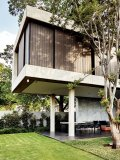 The first floor appears to almost float above the hollow ground floor. The landscaping by Patrick Watson is entirely indigenous and is designed to appear almost as an extension of the architecture. The design is based on a structured grid of grasses of varying textures and lengths picking up on the lines of the house