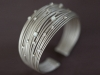 This mother-of-pearl silver wire cuff was inspired by the magic of tropical night skies