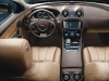 Classic Jaguar luxuries, polished wood and soft leather, with modern technology