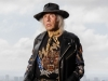 James Goldstein dons a jacket by designer Balmain while posing | Photography by Jesse Milns