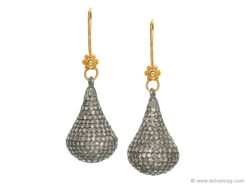 14-karat gold with these teardrop earrings