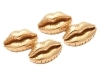 18-karat gold lip cufflinks by Michael Kanners