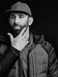 Bautista models his Canada Goose x Jose Bautista limited-edition jacket. The jacket was available for a limited run of 190 pieces at Harry Rosen, paying homage to Bautista's jersey number 19