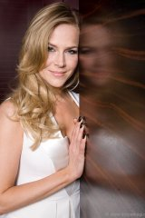 Actress Julie Benz leans against the zebrawood walls of the Hazelton Hotel's Bellair Suite