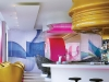 Pink, blue and gold line the walls and plastic fixtures of this highly stylized bar at the Nhow Hotel. Photography by Lukas Roth