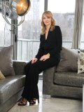 An authentic stage-set movie lamp overlooks Stewart as she sits in her downtown Toronto condo