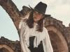 Blouse, Dolce & Gabbana; Pants, Elie Saab; Belt, Alberta Ferretti; Hat, Maison Michel; Bag, Dolce & Gabbana; Shoes, Gucci